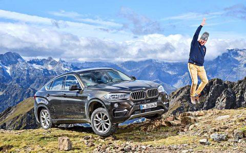 FAT Chefredakteur Hartmut Adam mit dem BMW X6